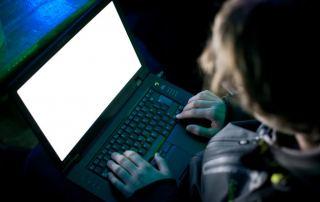 Man hacking a computer