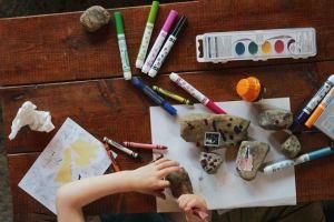 Child doing craft - lockdown activities for kids